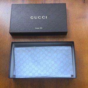 Empty Gucci sunglasses box and Gucci tissue paper